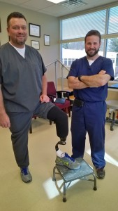 Tim Muncy demonstrates his new AllPro foot prosthetic with Prosthetist Orthotist Carey Bunch.